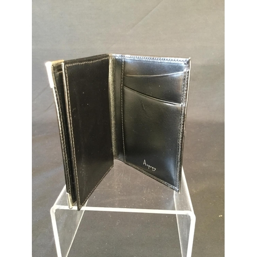 34 - Asprey of London black wallet / card holder with hallmarked silver corners. Comes in Asprey velvet b...