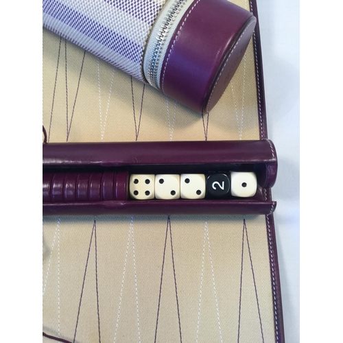 35 - Asprey of London travel draughts set. Both ends in plum coloured leather....