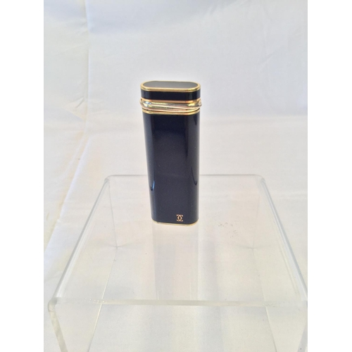 39 - Cartier Black Lacquer & Gold Plated trinity oval Lighter....