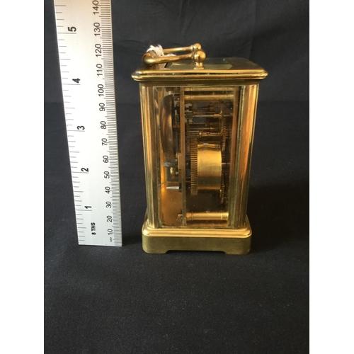 4 - 20th century chiming carriage clock with alarm. Bevelled glass, 2 spring barrels, original platform ...