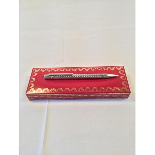 41 - CARTIER; a Must de Cartier platinum plated ball point pen. Comes in original Cartier box....
