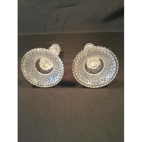 44 - Baccarat French pair of crystal glass candlesticks in hobnail cut. They measure 18cm in height....
