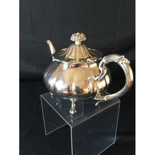 55 - Beautiful silver hallmarked teapot weighing 940 grams. Hallmark is Sheffield dated 1973. teapot has ...