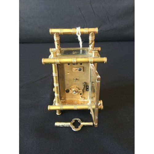 7 - Elliot miniature carriage clock. Porcelain panels hand painted with bamboo pillared cage style. Mini...