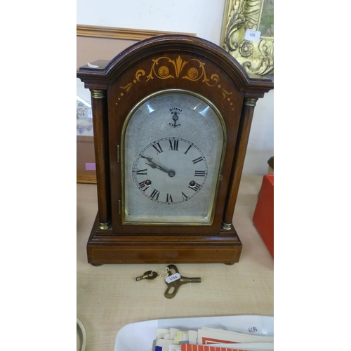 Edwardian Sheraton Revival Satinwood Inlaid Mantel Clock the Arch Top above a Silvered Engraved Dial with Roman Numerals, Brass Bezel, Flanked with Turned Columns Complete with Winding Key.