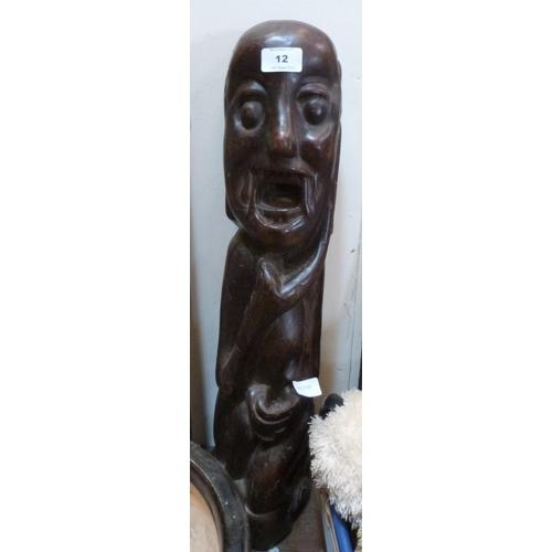 12 - An ethnic carved hardwood figure. 24' high...