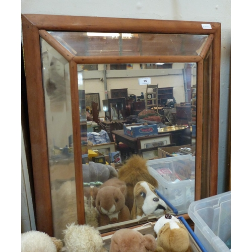 15 - A pine wall mirror with sectional bevelled plates 33' high...