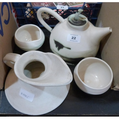 22 - A contempory style pottery four piece tea service...