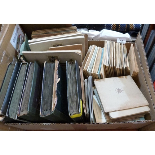 42 - A box of cigarette cards in albums...