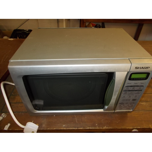 62 - Silver Sharp Microwave...