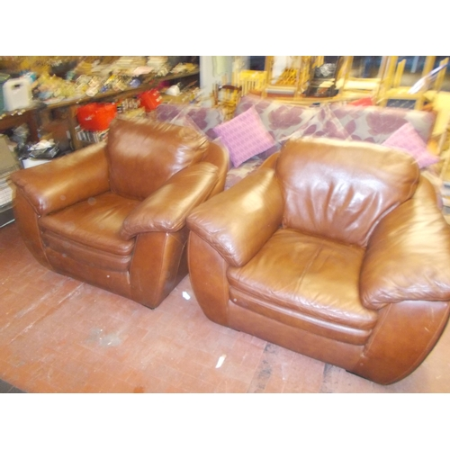 147 - 2 Brown Leather Chairs...