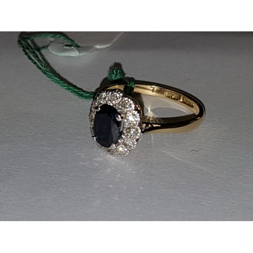 229 - 18ct Sapphire and 12 Diamond ring...