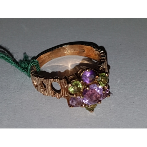 234 - 9ct Amethyst and peridot Cluster...