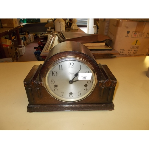 242 - Mantle clock with key and pendulum...
