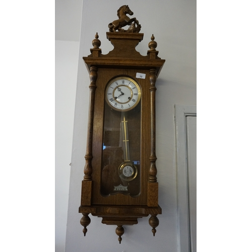 12 - Victorian style Vienna oak cased wall clock...