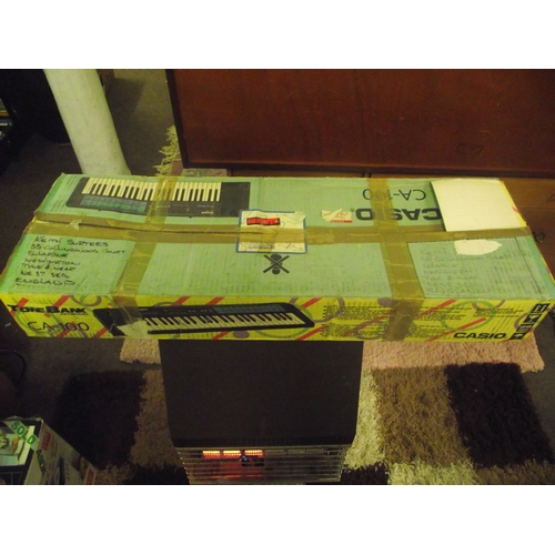 17 - Boxed Casio organ...
