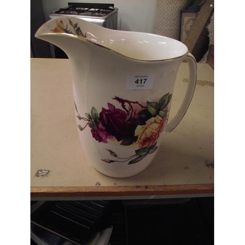 27 - Floral jug...