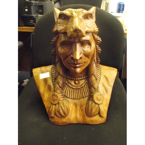 555 - Large heavily hand carved native american pine sculpture...