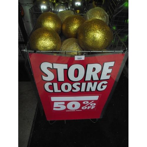 28 - Basket of gold balls. Basket not included...