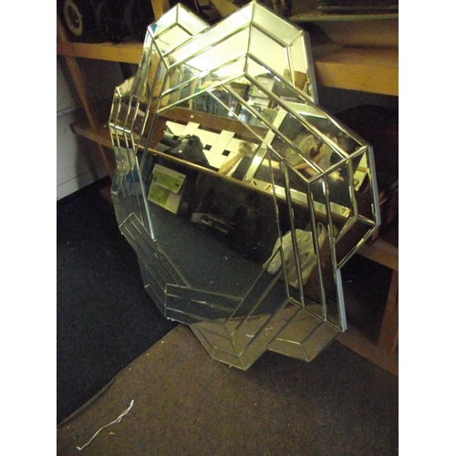 2 - 50p shape large glass mirror...