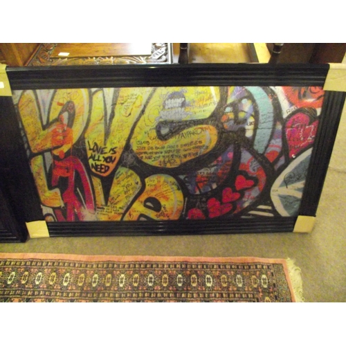 13 - Large Black framed Graffitti print on metal approx. 52 x 30 inches....