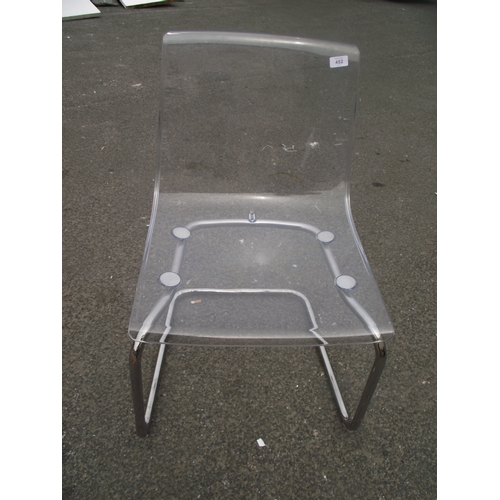 42 - Transparent and chrome chair...