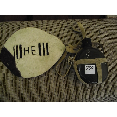 25 - Small african hide shield and Military WW2 water bottle/cannister....