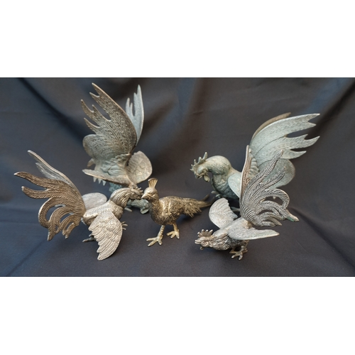 19 - 4 Heavy White metal fighting Cockerels +one other.Large approx 8 inches height smaller 5 inches....