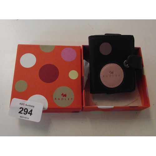 42 - Small boxed Radley leather photo frame...
