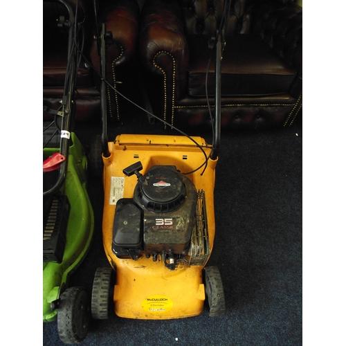 54 - Classic 35 petrol lawnmower fully working no basket....