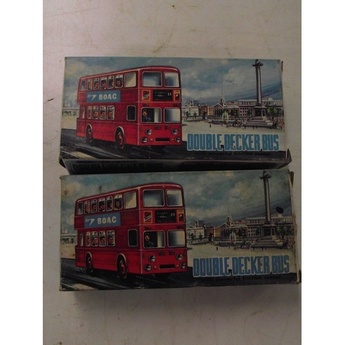 897 - 2 x friction vintage double decker buses- Boxed as new made in hong kong...
