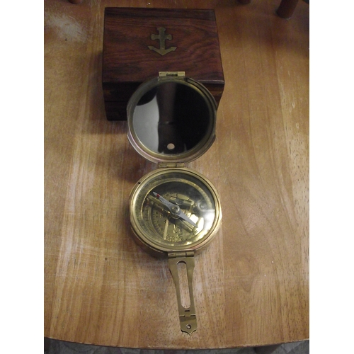 11 - Small boxed captains compass in brass...