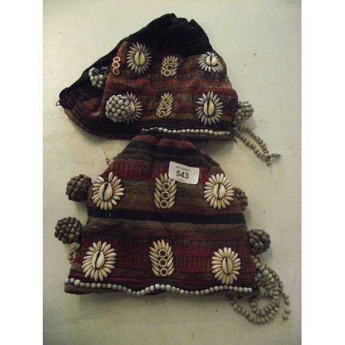 18 - 2 Tibetan hats with cowrie shells...
