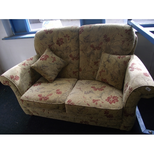 23 - Nice clean 2 seater settee....