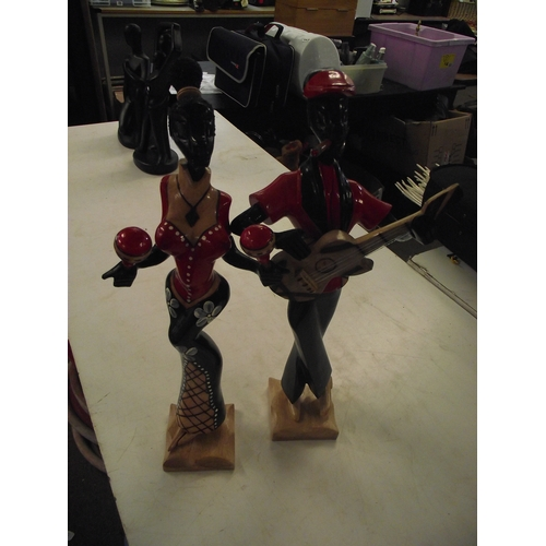 46 - Pair of Wooden musicians...