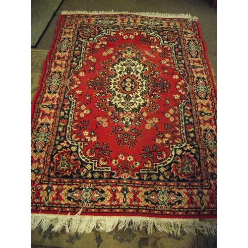 16 - Vintage red bordered rug...