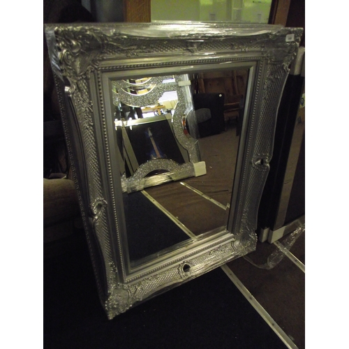 29 - Heavy silver ornate frmaed Mirror. 30 x 40 inches....