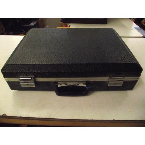 9 - Custom brief case....