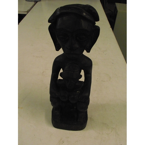 22 - Heavy well carved African hardwood fertility statue approx. 14 x4 inches....