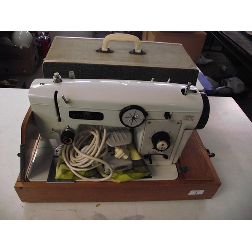 3 - Cased sewing machine by Crown...