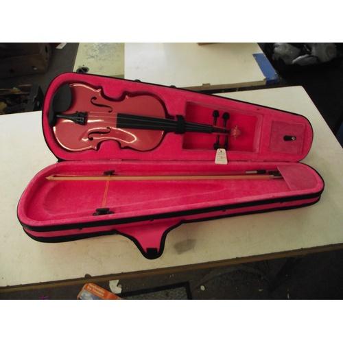 8 - Violin in case...