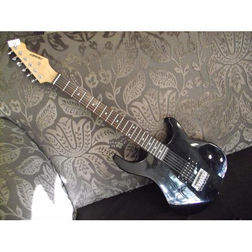 24 - Peavey black electric guitar....