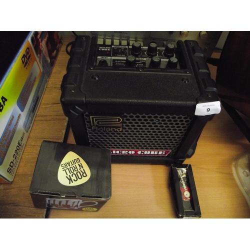 9 - Roland microcube amp + mug ect....