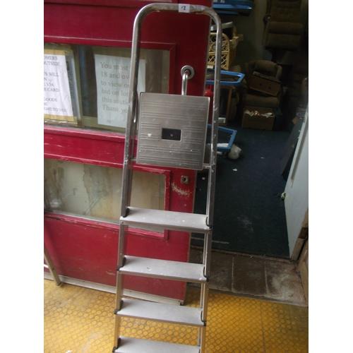 13 - Large aluminium step ladder....