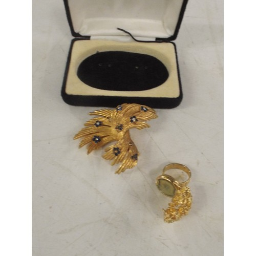 41 - Yellow metal brooch and perfumed ring...
