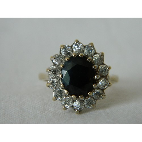 43 - Sapphire and CZ cluster 9 carat gold engagement/dress ring, the sapphire approximately 1.75 carats, ...
