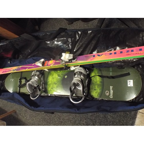 12 - Burton canyon snowboard, case and skis...