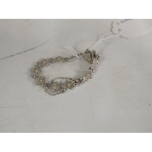 51 - Silver fillagree bracelet with safety chain...