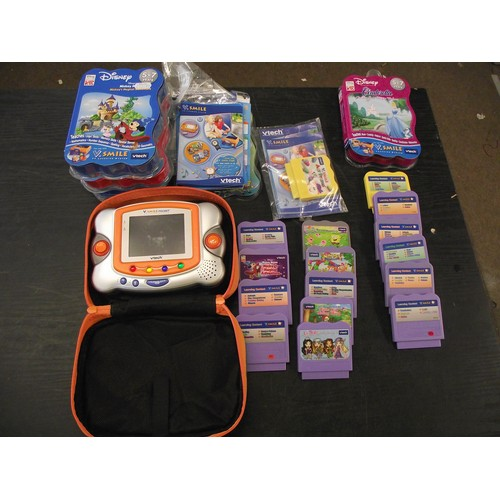 6 - V-Tech Vsmile pocket console with lots of games cartridges....