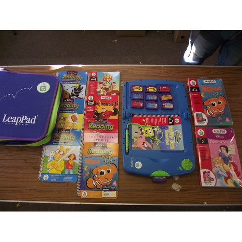 9 - Leapad learning tv system with lots of games cartridges books ect....